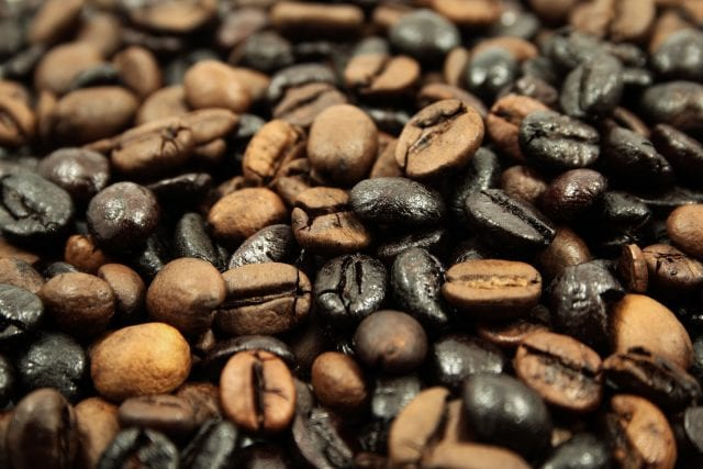 black and light coffee beans after the roasting procedure